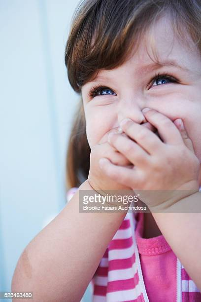 Girl with Hands Over Mouth