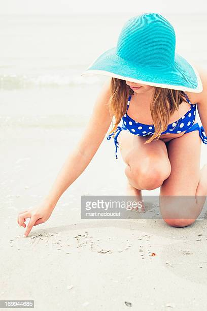 "girl with hat and bikini writing on beach. - ""martine doucet"" or martinedoucet bildbanksfoton och bilder"