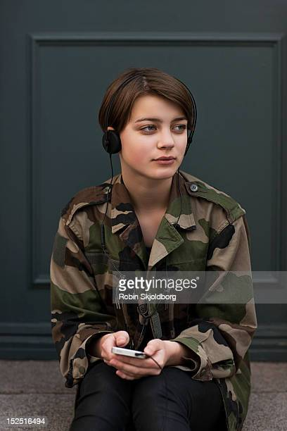 Girl with headphones and mobile