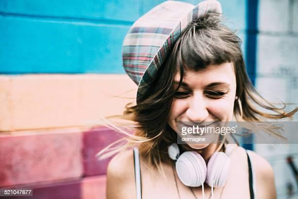 Girl with headphones shaking hair