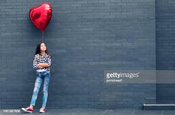 Girl with heart shape balloon