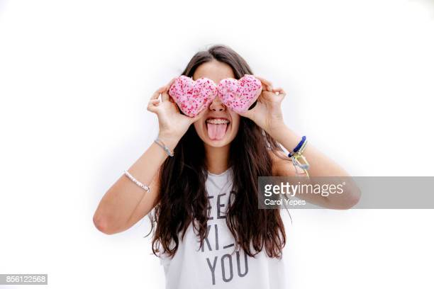 girl with heart shape  donuts in front of her eyes and ice cone on head - sugar pile stock pictures, royalty-free photos & images