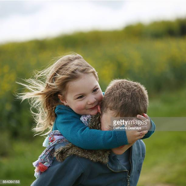 A girl with her big brother in the countryside