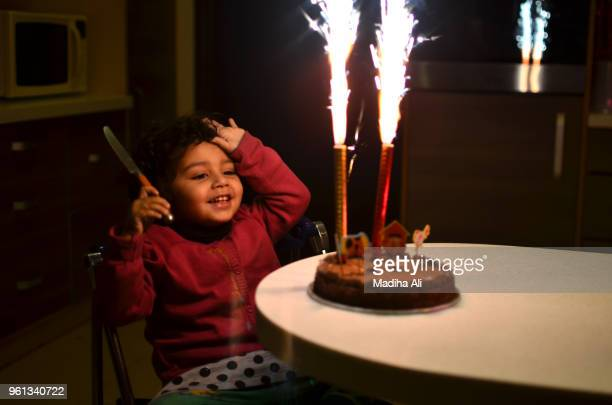 a girl with her birthday cake - happybirthdaycrown stock pictures, royalty-free photos & images