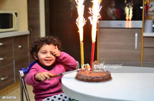 a girl with her birthday cake - anniversaire humour photos et images de collection