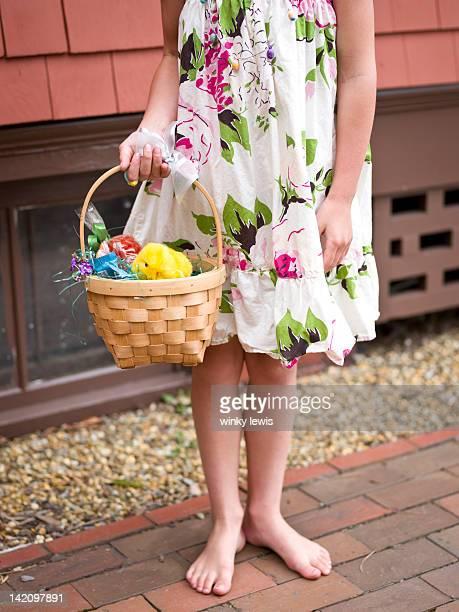 girl with her easter basket - osternest stock-fotos und bilder