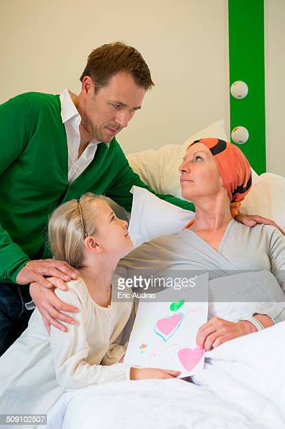 Girl with her father visiting to her mother in hospital