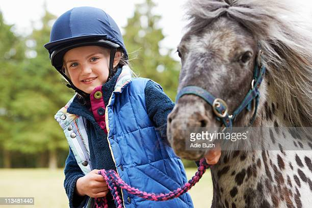 girl with her pony - girl blowing horse stock pictures, royalty-free photos & images