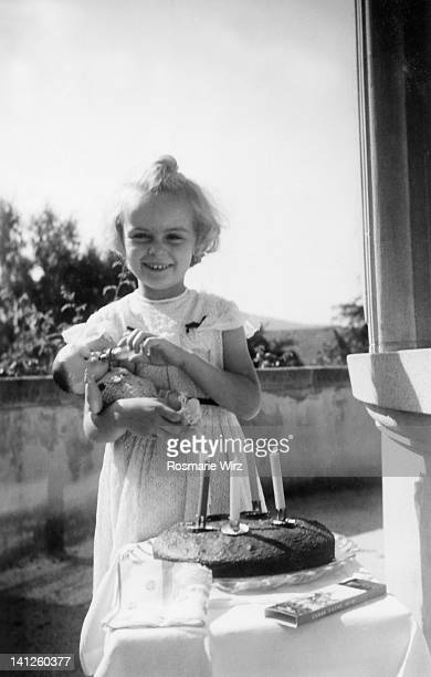 Girl with her soft teddy and cake