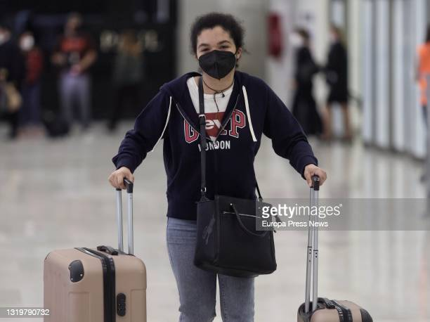 Girl with her suitcases arrives at terminal T4 of Adolfo Suarez - Madrid Barajas Airport on the first flight from London , on 24 May, 2021 in Madrid,...