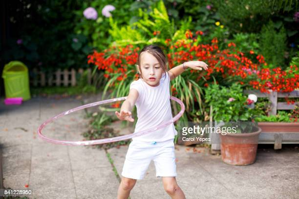 girl with hoola hop in park
