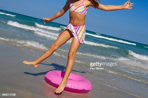 girl with inner tube at surf - girls with short skirts stock photos and pictures