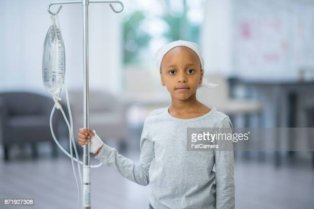 girl with iv - chemotherapy stock pictures, royalty-free photos & images