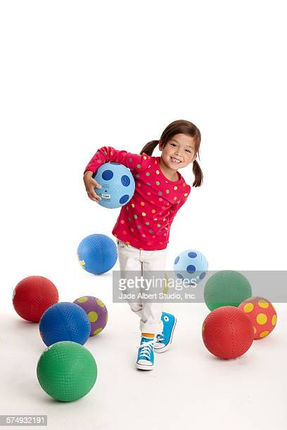 girl with kickballs - kickball stock photos and pictures