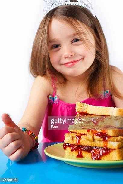 Girl with Large Peanut Butter and Jelly Sandwich