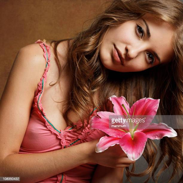 girl with lily - stargazer lily stock photos and pictures