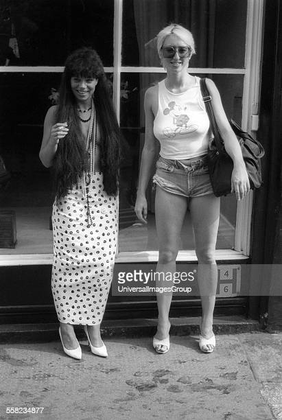 Girl with long hair and no top London 1980s