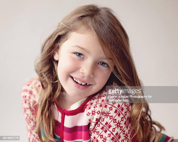 Girl with long hair in striped sweater