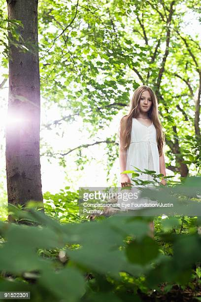 """girl with long hair standing in a forest - """"compassionate eye"""" stock pictures, royalty-free photos & images"""