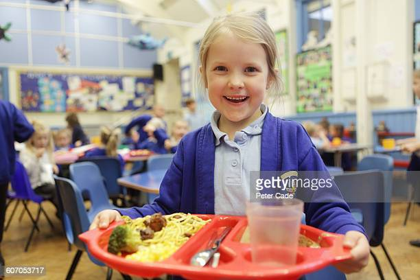 girl with lunch in school dining hall - meal stock pictures, royalty-free photos & images