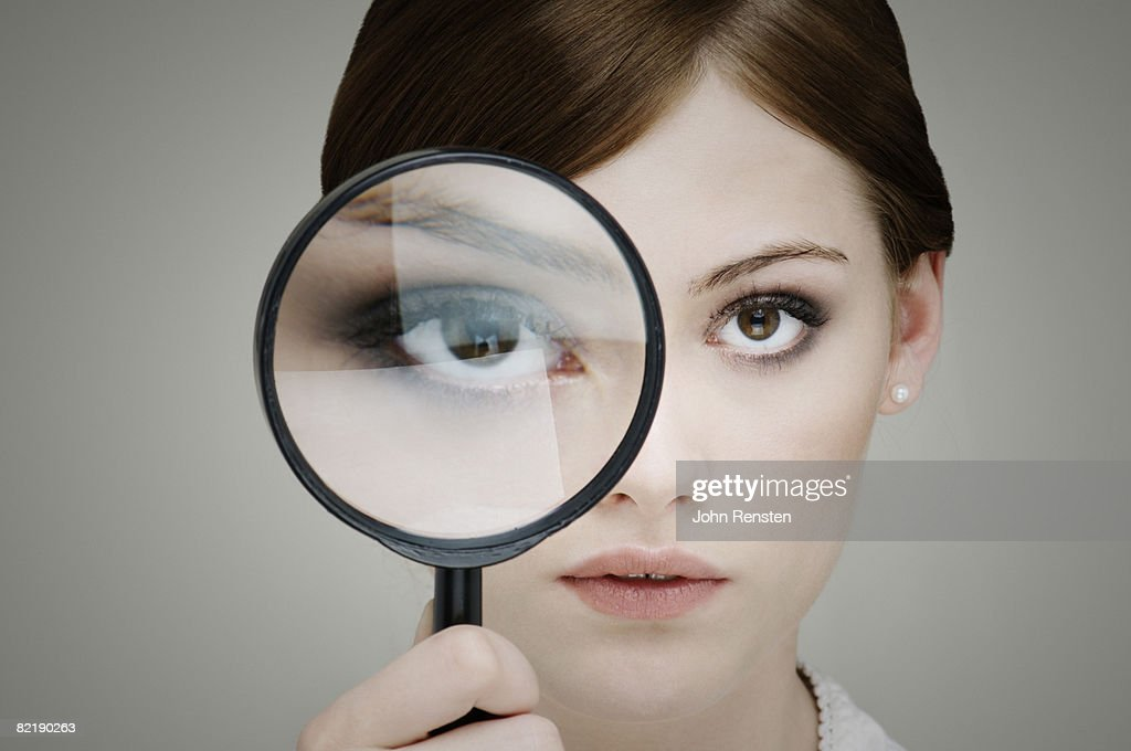 girl with magnifying glass : Stock Photo