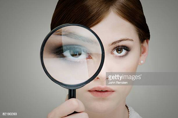 girl with magnifying glass - big eyes stock photos and pictures