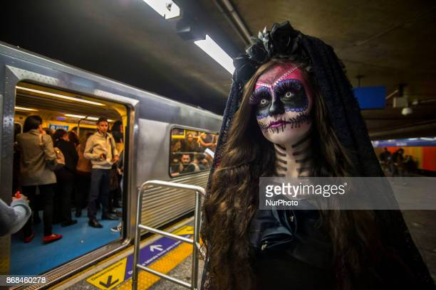 A girl with makeup and costumes of the Mexican character La Catrina is seen traveling on the subway in São Paulo on October 30 2017 La Catrina is...