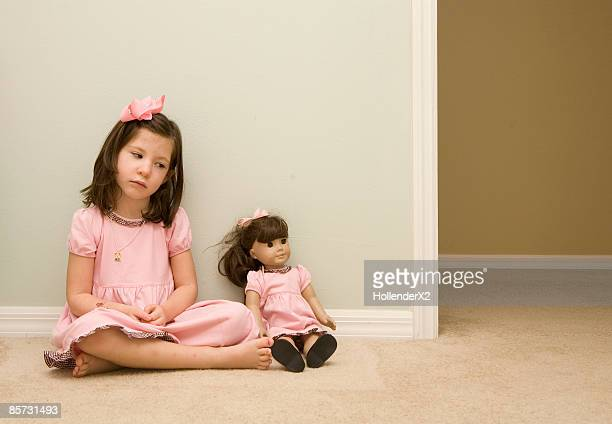 girl with matching doll