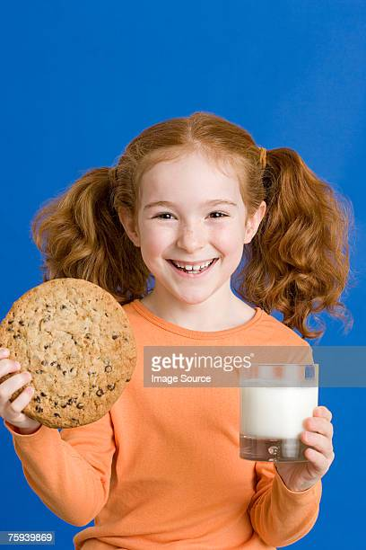 Girl with milk and cookie