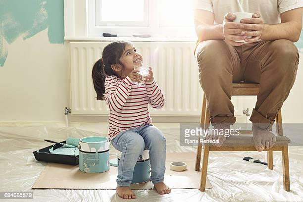 girl with milk glass smiling at dad - coffee break stock pictures, royalty-free photos & images