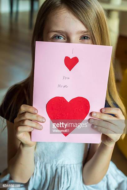 girl with mother's day card - little girls giving head stock photos and pictures