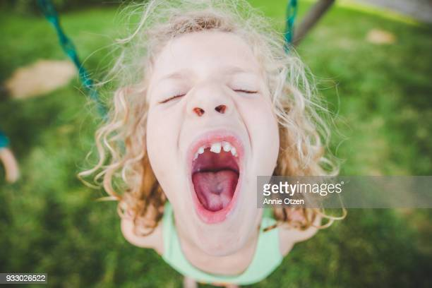 girl with mouth very wide open - girls open mouth stockfoto's en -beelden