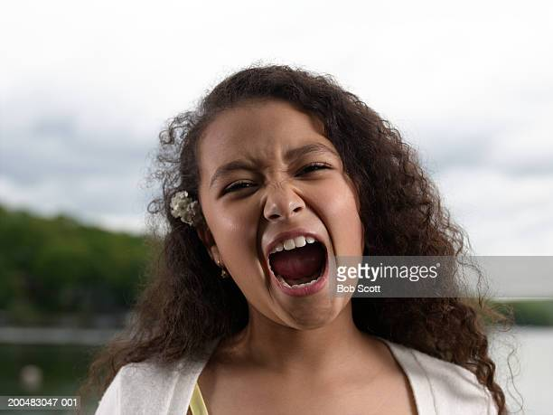 girl (8-10) with mouth wide open, close-up - girls open mouth stock photos and pictures