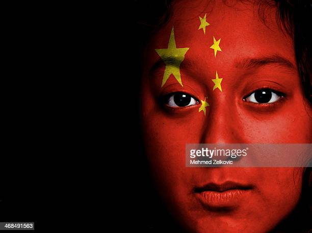 Girl with national flag on her face
