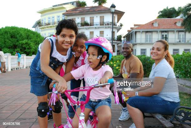 girl with new bike on christmas day in panama city, panama - panama stock pictures, royalty-free photos & images