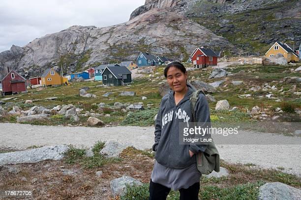 Girl with New York sweatshirt in village