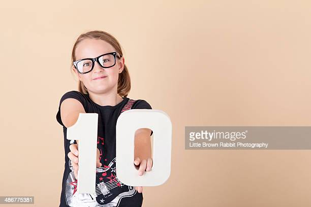 girl with number 10 and geek glasses 2 - 10 11 years stock photos and pictures