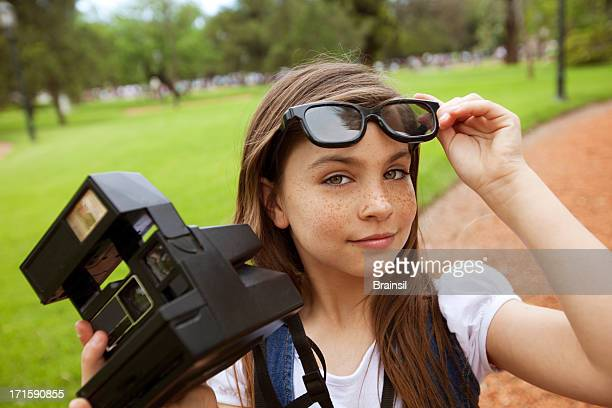 girl with old camera - girls flashing camera stock pictures, royalty-free photos & images