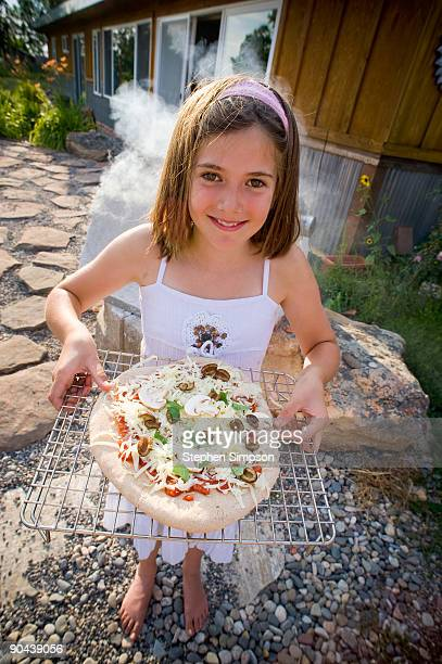 girl with outdoor backyard pizza
