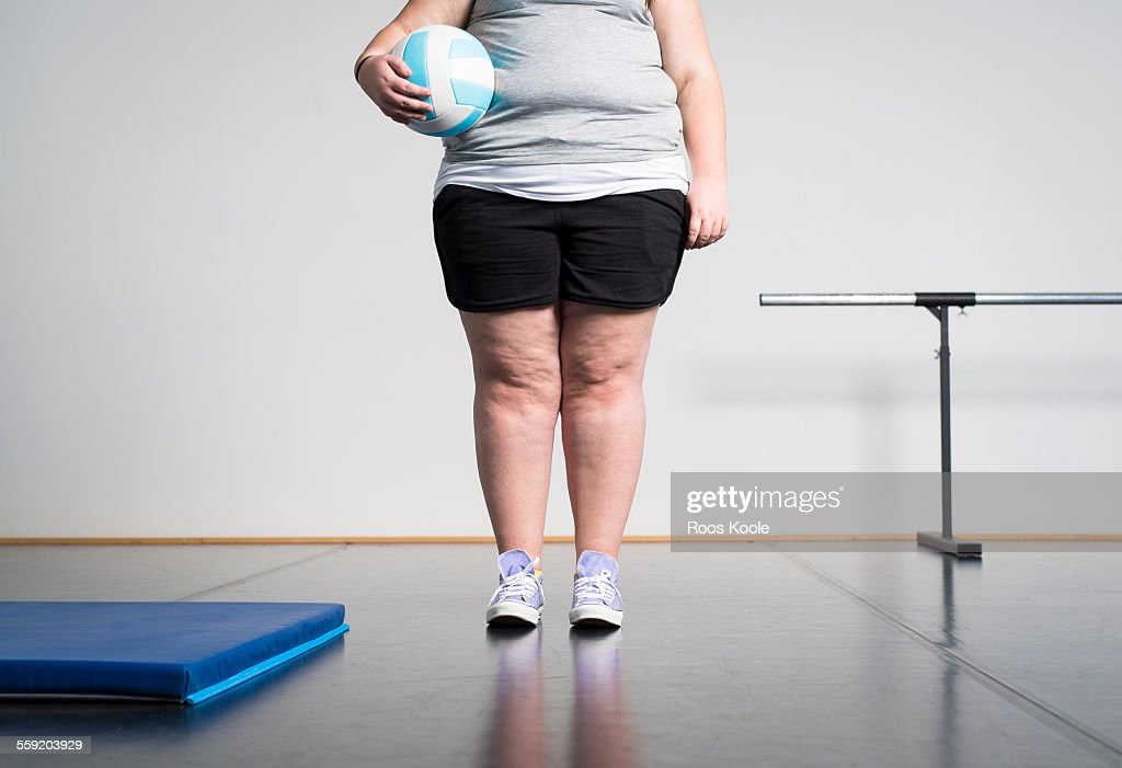 Girl with overweight in gym : Stock Photo