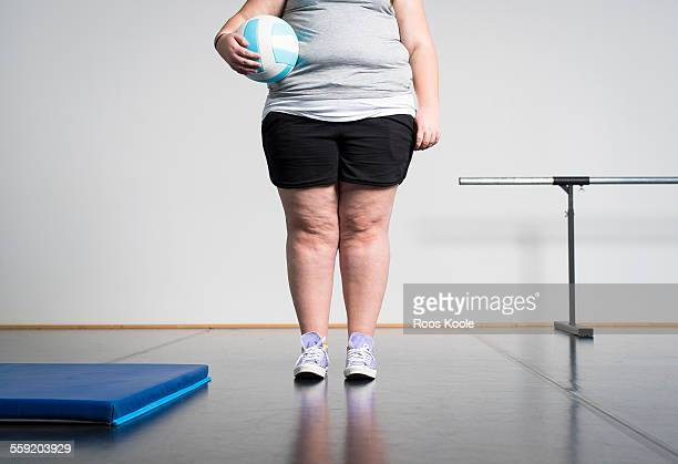 girl with overweight in gym - fat belly girl stock photos and pictures