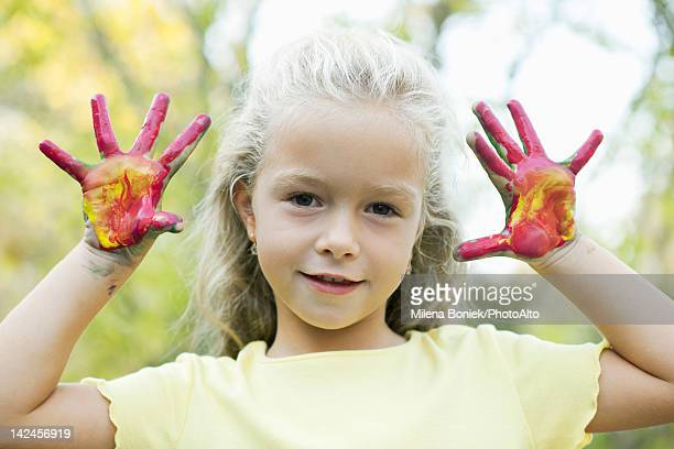 girl with paint covered hands, portrait - 4 girls finger painting stock photos and pictures