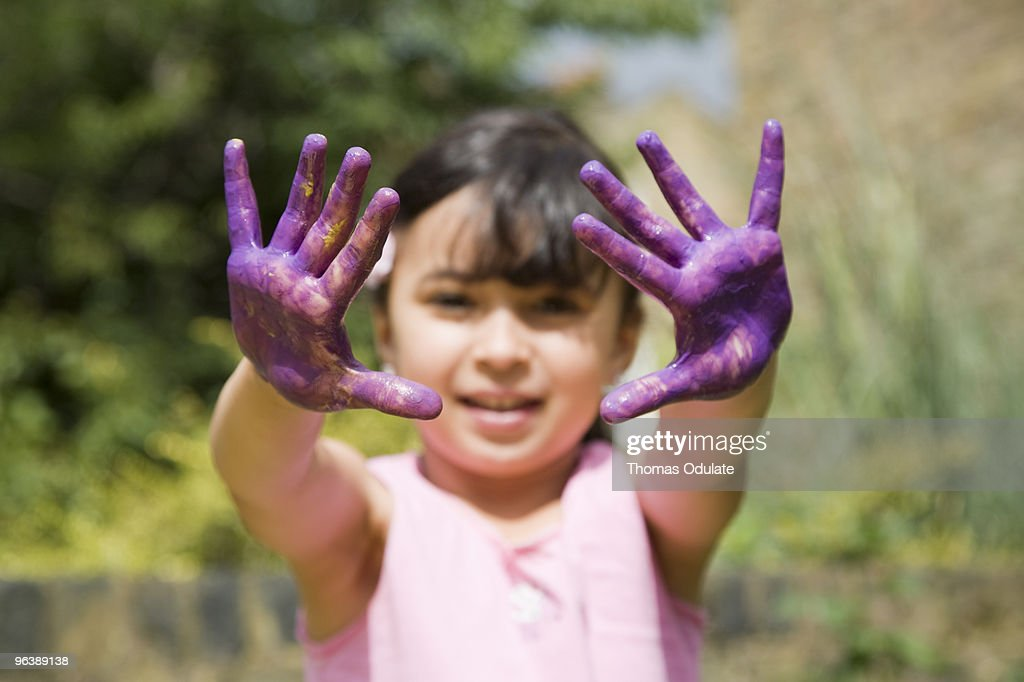 Girl with painted hands : Stock Photo