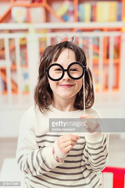 girl with paper spectacles and silver crown