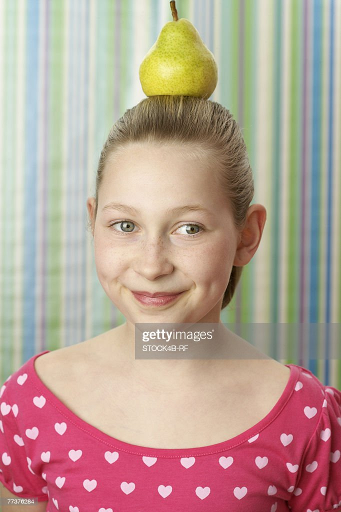 Girl with pear on top : Stock Photo