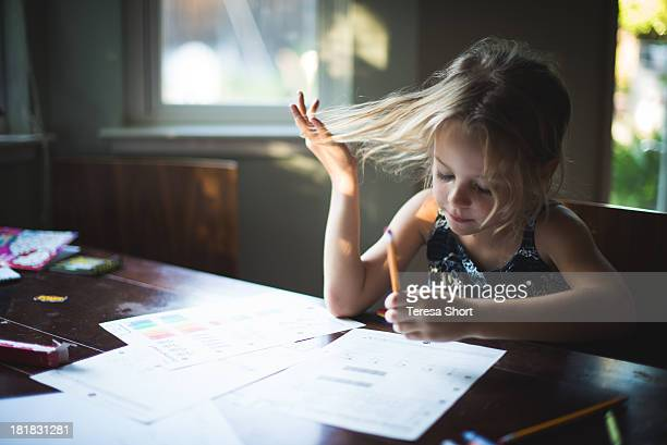 girl with pencil doing homework - homeschool ストックフォトと画像