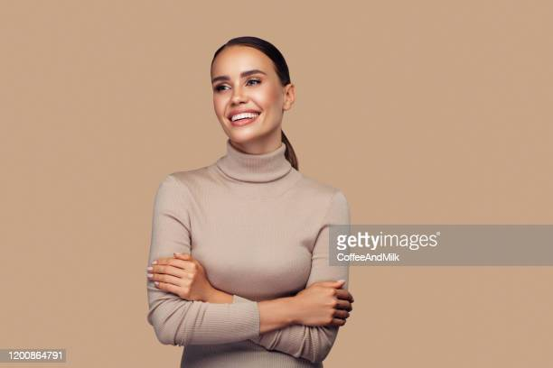 girl with perfect smile is posing at the studio - beautiful woman stock pictures, royalty-free photos & images