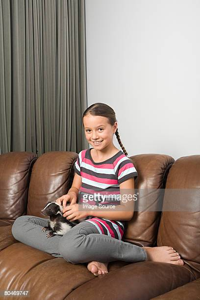 girl with pet skunk - skunk stock photos and pictures