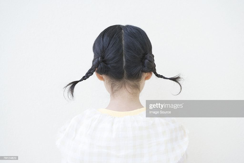 Girl with pigtails : Stock Photo