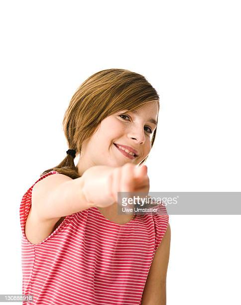 Girl with pigtails, pointing forward